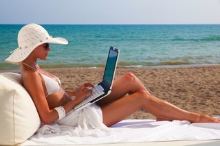 Laptop-abroad work online at home or beach